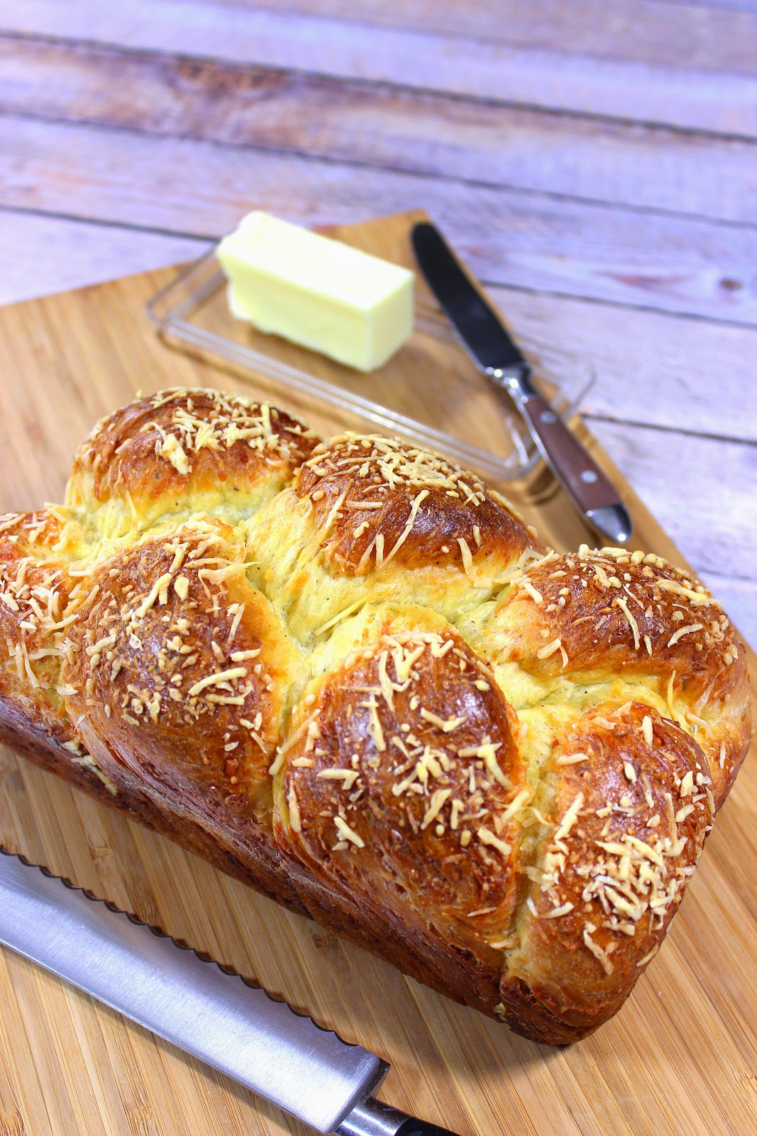 The texture of this golden egg, Italian Easter Cheese Bread is incredibly light and airy. In addition it's loaded with so much Italian cheese that the crust is super crispy and crunchy.