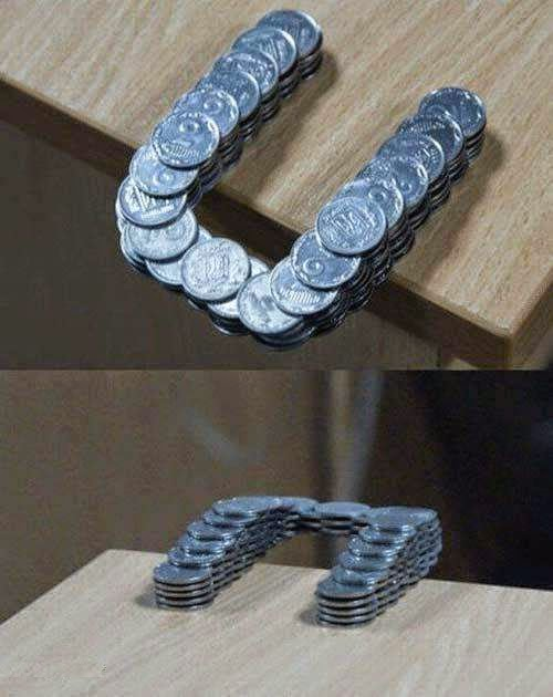 46 Unbelievable Photos That Will Shock You - Coins Stacked in Such a Way That They Extend Past the Edge of the Table