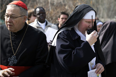 Nun uses walkie-talkie during Good Friday event