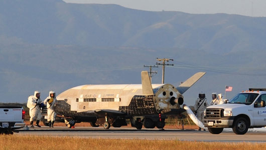 I SPY WITH MY LITTLE SPACE PLANE: The Air Force's X-37B robotic space plane sits on the runway after landing at California's Vandenberg Air Force Base on June 16. The plane was in orbit for more than 15 months on a classified mission. (Photo: Boeing)