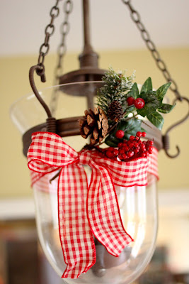 lantern decorated for Christmas with red check ribbon via www.goldenboysandme.com