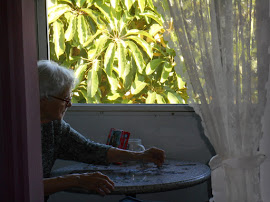 Mom on my porch, doing the same jigsaw puzzle she does every day.
