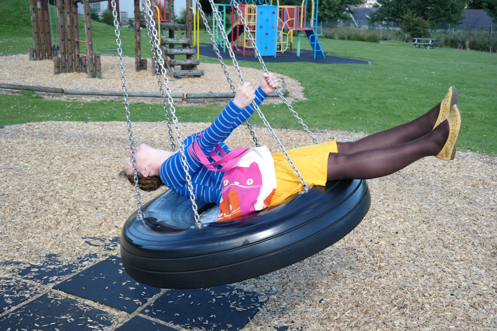 Sarah Rooftops on a tyre swing