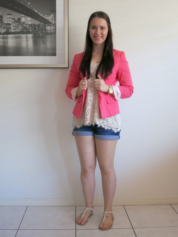 Dark wash denim shorts, cream lace top, coral blazer & gold accessories