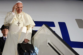 Pope on steps of plane
