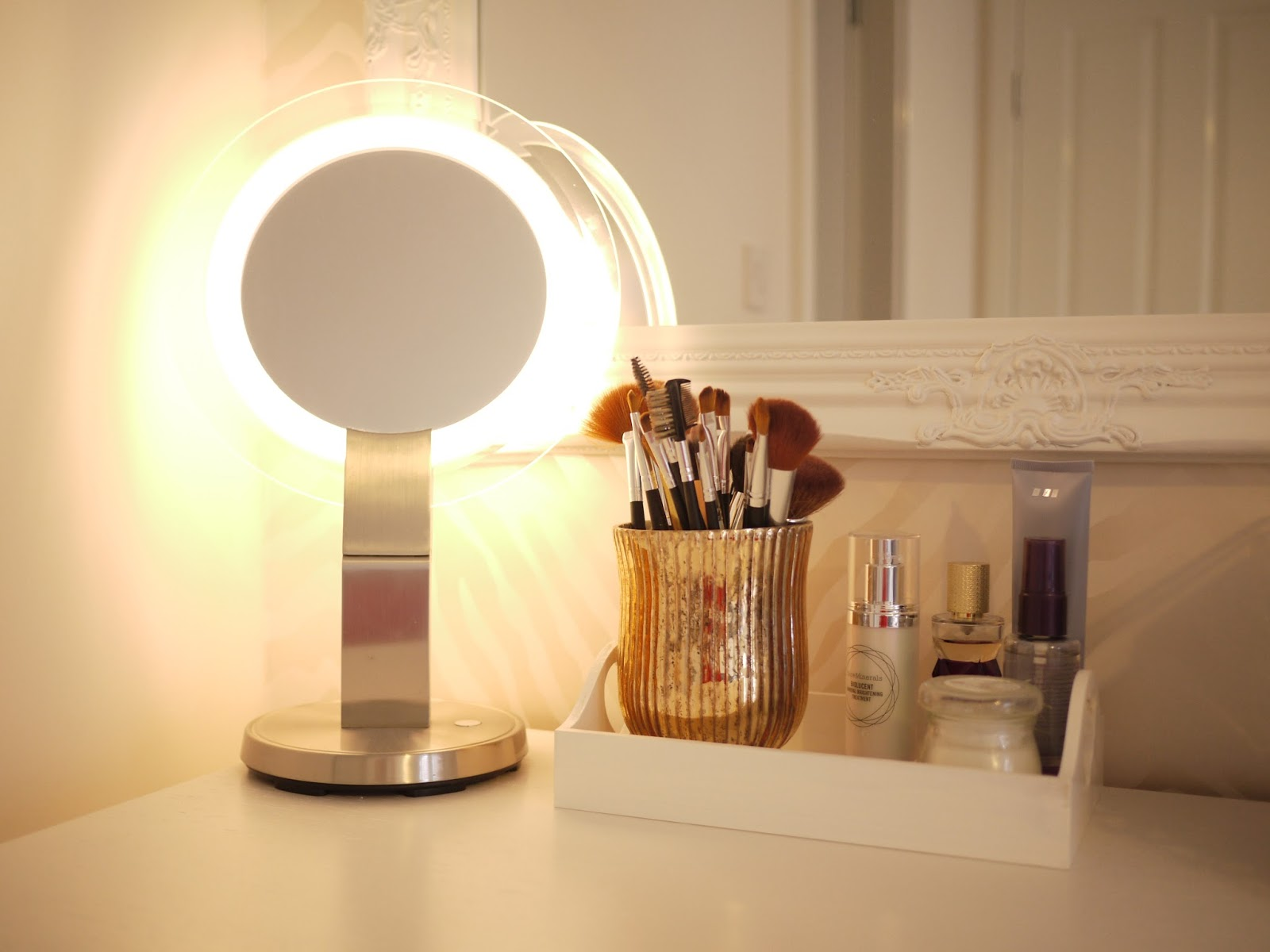 A picture of my dressing table with mirror and make up brushes