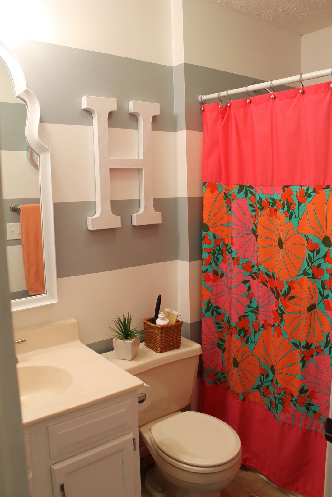 Hems and haws coral painting for Teen girl bathroom ideas