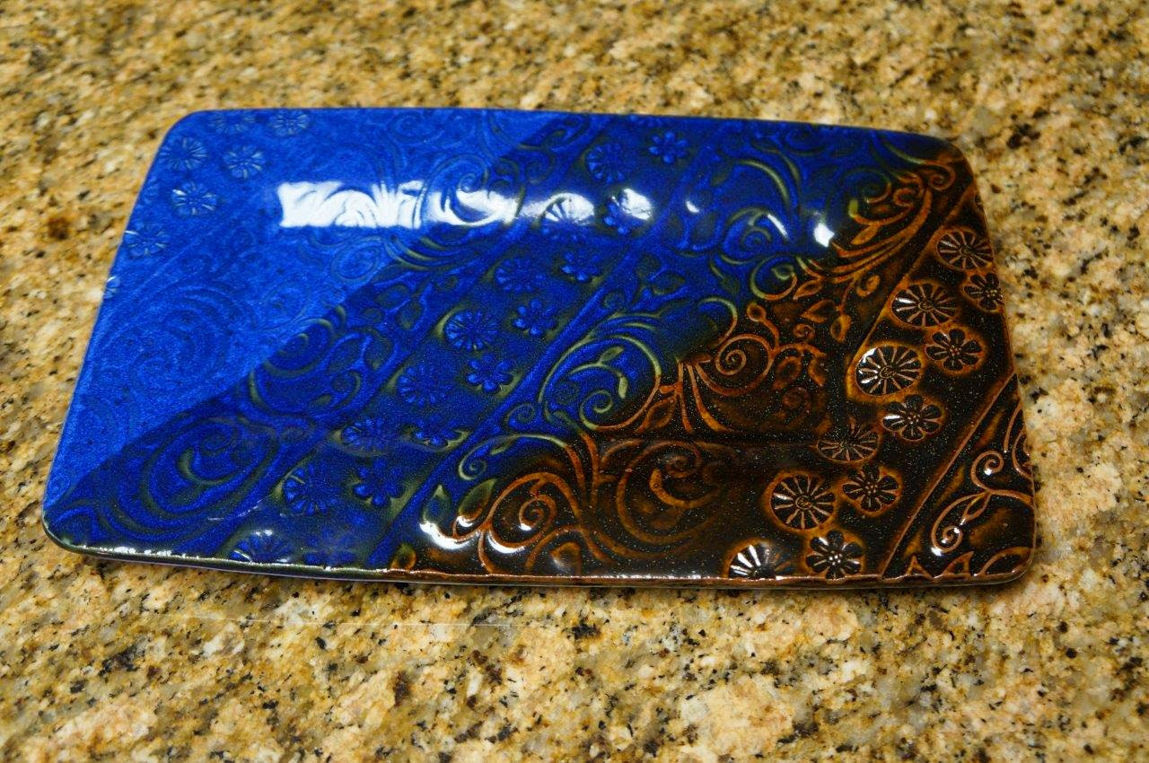 Beautiful handcrafted ceramic plate / tray with stamp and roller design.