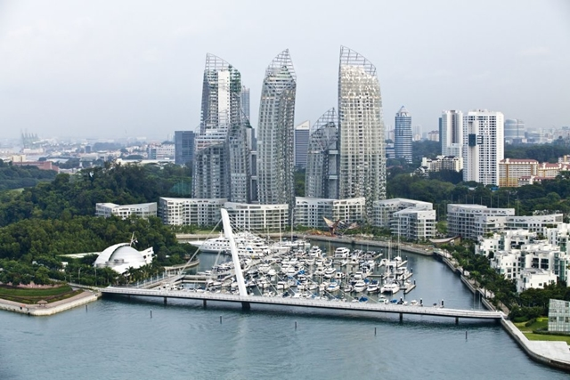 Reflections at Keppel Bay by Studio Daniel Libeskind from the air with the bridge
