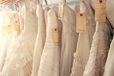 wedding gowns on a rack