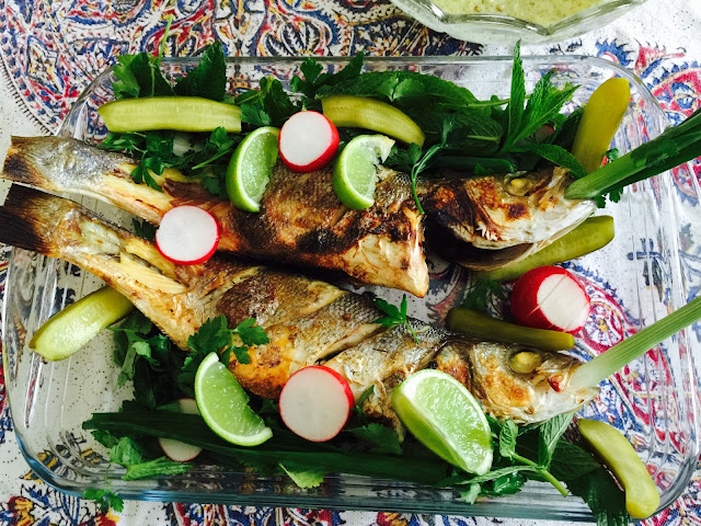Iranian raisin stuffed sea bass with lemon and herbs