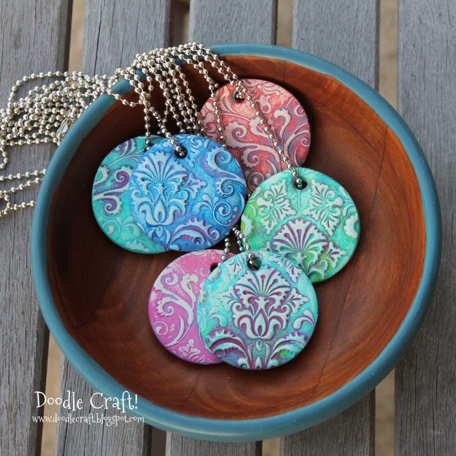 http://www.doodlecraftblog.com/2014/04/damask-polymer-clay-pendants.html