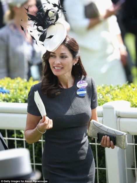 Miss Tomanovic looked very glamourous in a slate-coloured dress and white fascinator hat on Ladies' Day of Royal Ascot 2014