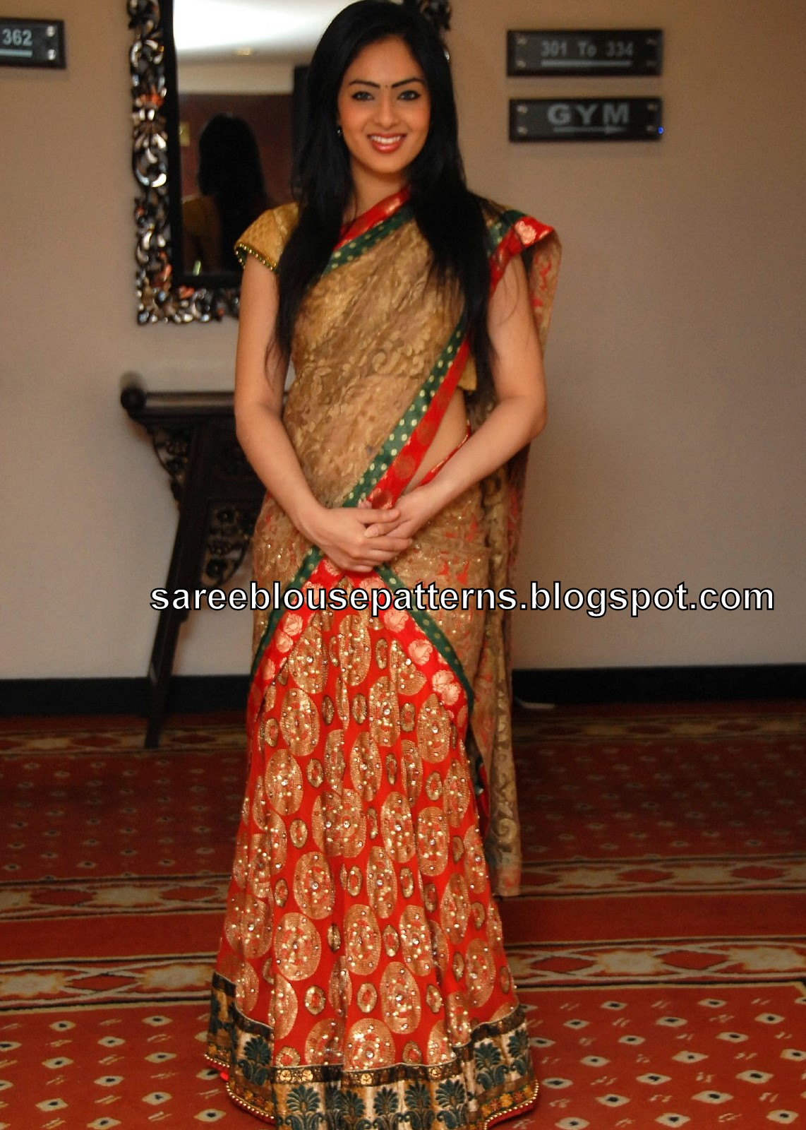 Half Saree Designers in Hyderabad http://www.celebritysaree.com/2011/05/nikesha-patel-in-designer-half-saree.html