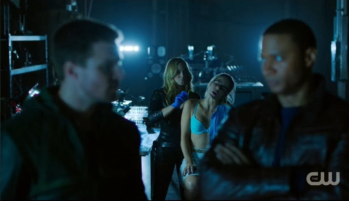 Sara stitching up Felicity in turquoise bra bullet wound Arrow Time of Death episode Diggle and Oliver watch