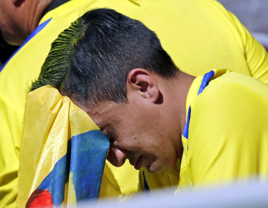 An Ecuadorean fan sits in the stands following Ecuador's 2-1 loss to Switzerland during the group E World Cup soccer match between Switzerland and Ecuador at the Estadio Nacional in Brasilia, Brazil, Sunday, June 15, 2014.