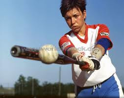 woman hitting baseball