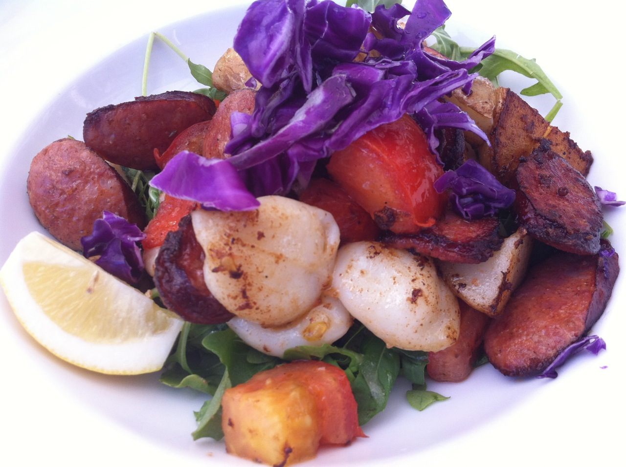 Grilled squid, chorizo, tomatoes, new potatoes, roquette, cabbage ...