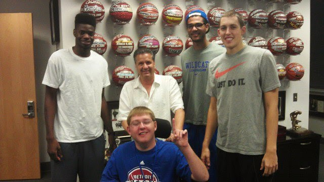 Kevin Massey With Coach John Calipari And UK Star Players