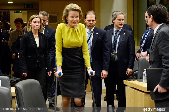 Queen Mathilde of Belgium walks with crutches as she arrives along with EU foreign policy chief Federica Mogherini to attend a conference on Ebola on March 3, 2015 in Brussels