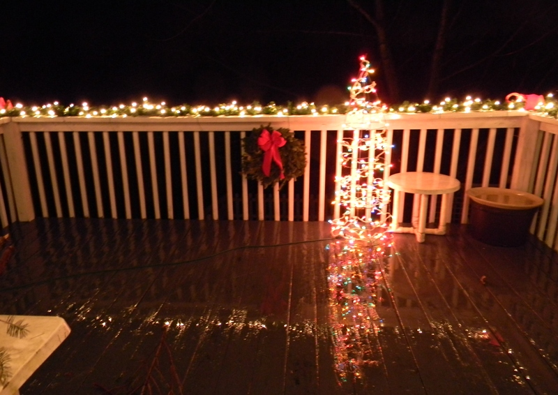 Swac girl christmas light reflections on a cold rainy night on a cold rainy night the christmas lights offer a cheerful reflection on the deck mozeypictures Gallery