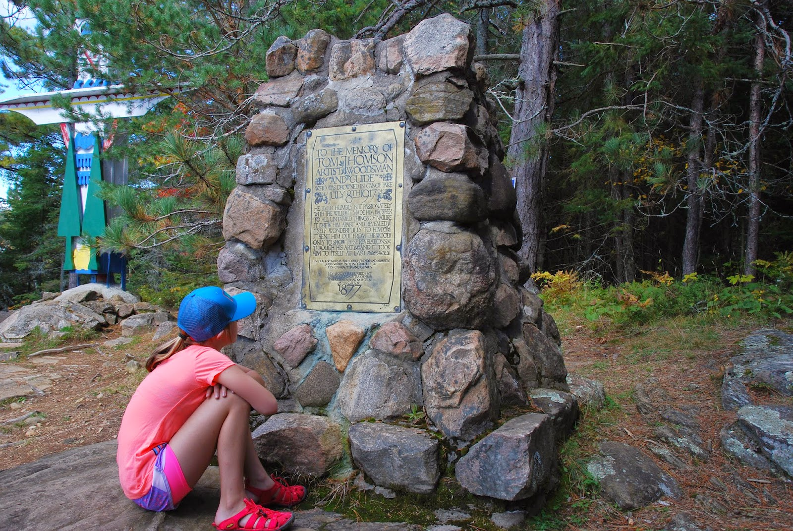 Visiting Tom Thomson memorial cairn and totem pole, Canoe Lake, Algonquin Park