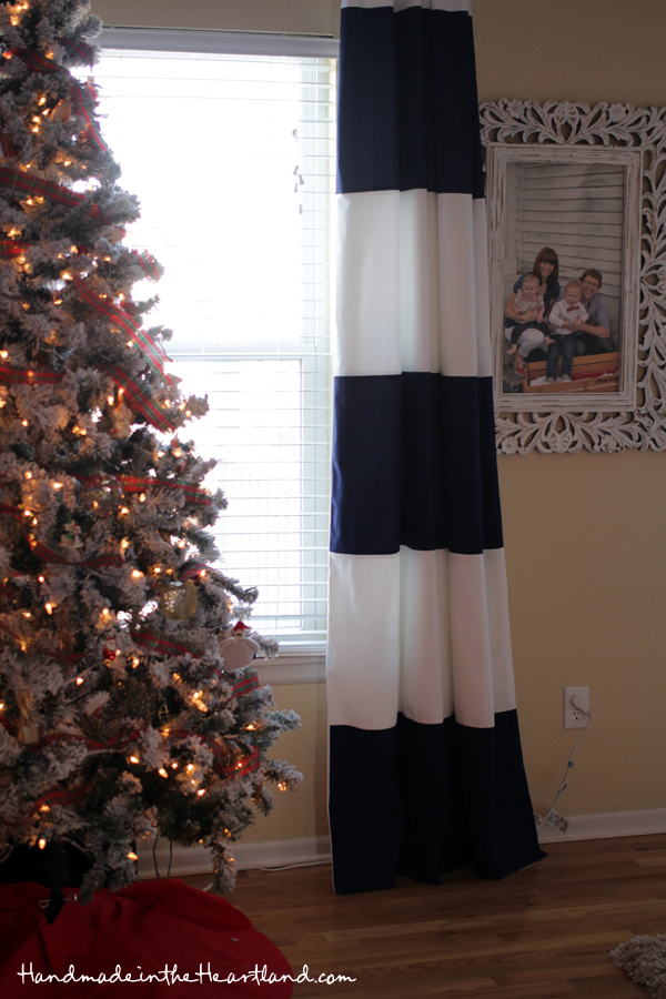 flocked Christmas tree, striped curtain