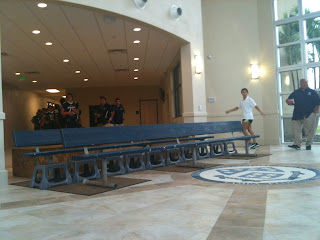 In the entrance of the Straz Family Field House, the benches have been laid out and the seal is down in front.