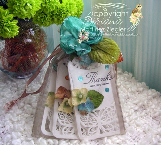 muslin bag with gift tags made with petaloo flowers