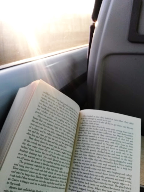 Open book by train window