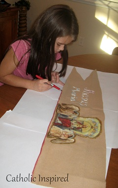 After finding a nice straight stick (you could buy one if you need or use a broom stick) we hot glued around it and folded the end of the banner over it. & St. Joan of Arc ~ Costume - Catholic Inspired