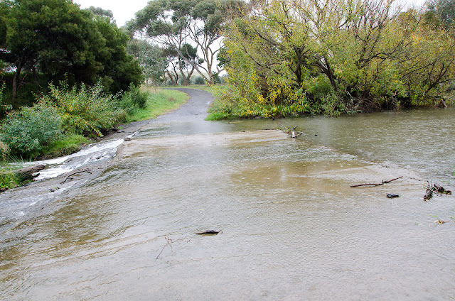 ford covered in water on bulla-diggers rest road