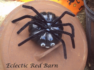rusted cast iron lid with pumpkin spider