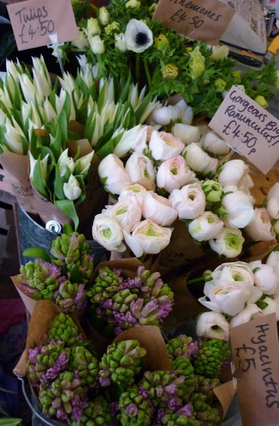 flowers for sale, european flower market, blooming bunches of flowers, tulips, hyacinth, ranunculus, anemones