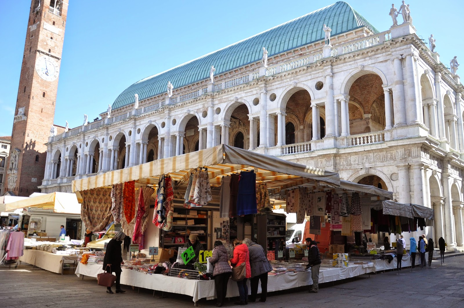 A stall at Piazza dei Signori in front of Palladio's Basilica - Thursday market in Vicenza, Italy