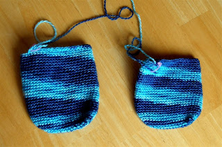 entrelac socks in shades of blue with the feet partially done