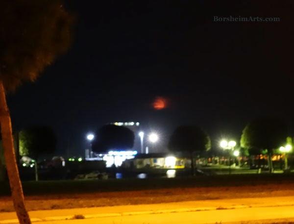 Red big full moon setting around 6 a.m. in Umag, Croatia