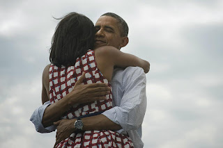 Barack Obama President Of America hugging her wife on beach share on twitter and facebook