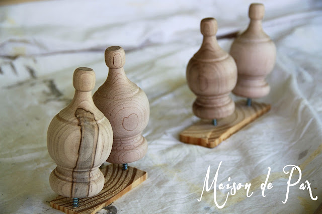 TIP: Screw knobs or finials into scrap wood before staining or painting to get an even finish