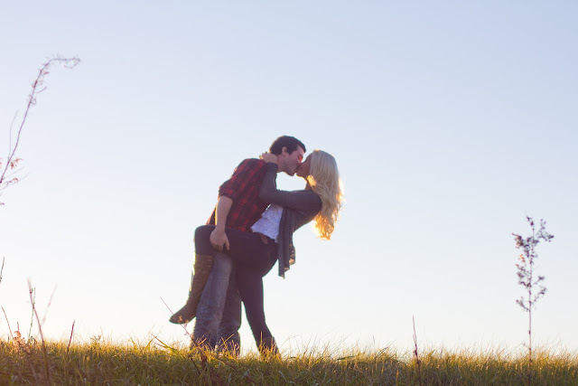 sun soaked image of a couple dipping
