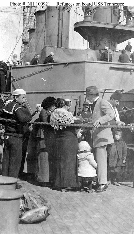 Photo of sailors and refugees on deck of USS Tenessee