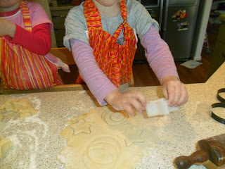 Child cutting out biscuits in a kid friendly recipe.