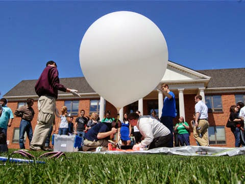 Students about to send a weather balloon into the atmosphere