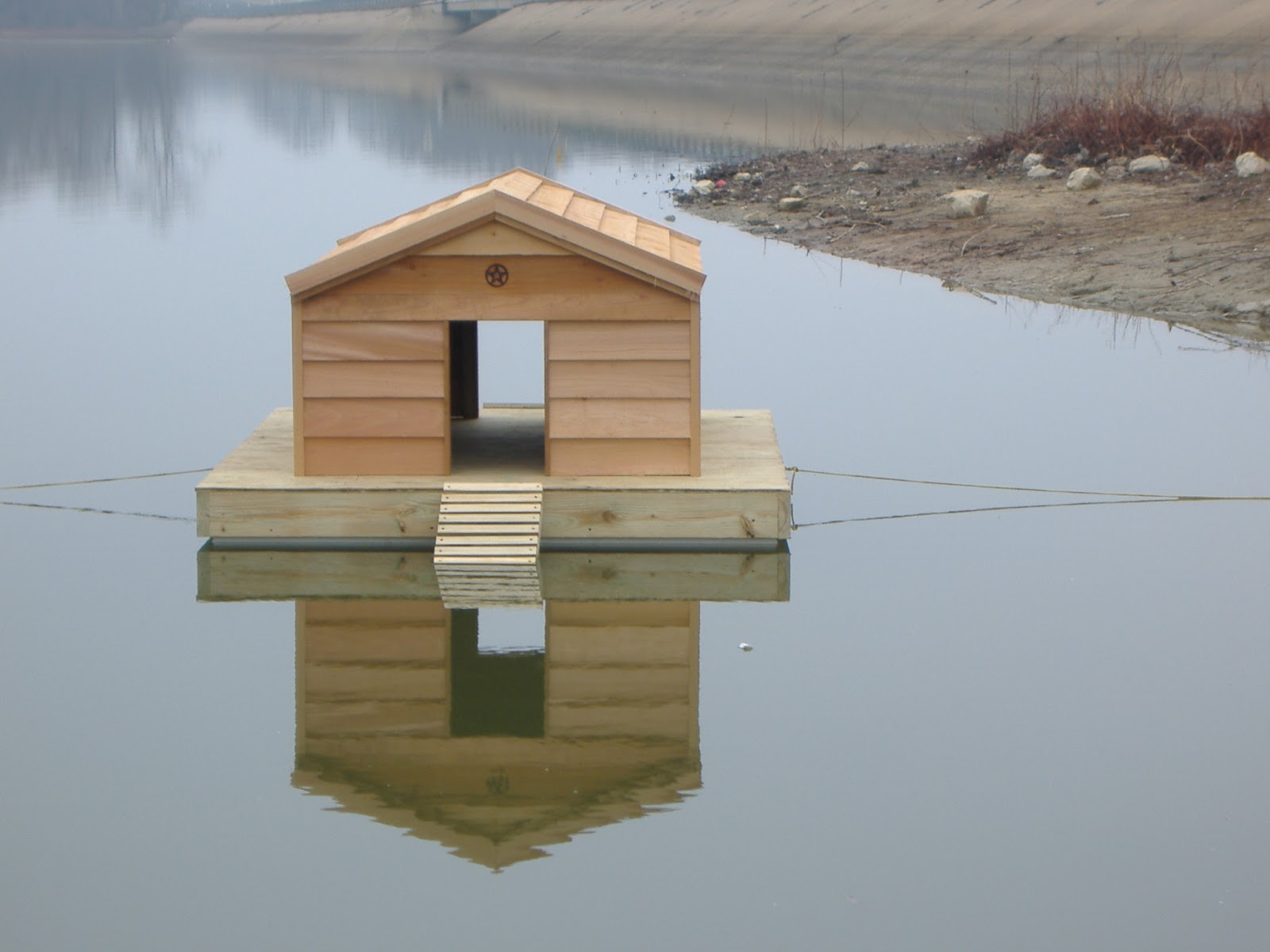 Custom floating duck houses custom ac heated insulated for Building a house