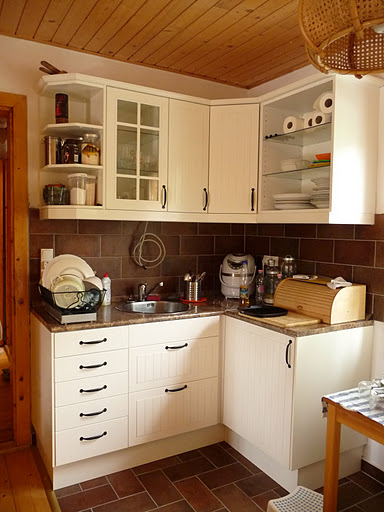 Stuff We Used: White Kitchen   IKEA Stat With Butterum Granite Countertop  And Brown Tile Backsplash