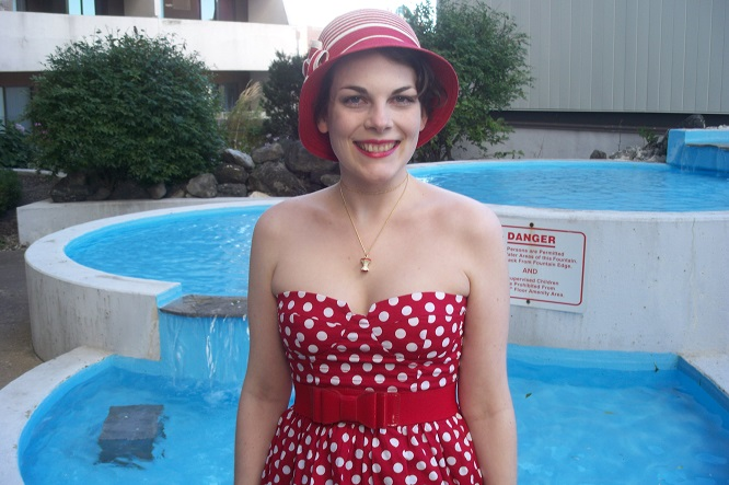 modcloth.com, Modcloth hat, Keep Your Friends Cloche, red and white polka dot dress, 1950s style, 50s inspired fashion, 1920s style, 20s inspired fashion, pin up girl, dress with sweatheart neckline, girl posing by Victoria Park Place fountain, Core Values Necklace, Suzanne Amlin, A Coin For the Well, Windsor Ontario fashion blog, style blogger, red bow belt