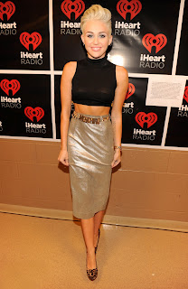 Miley Cyrus silved skirt and tight black top