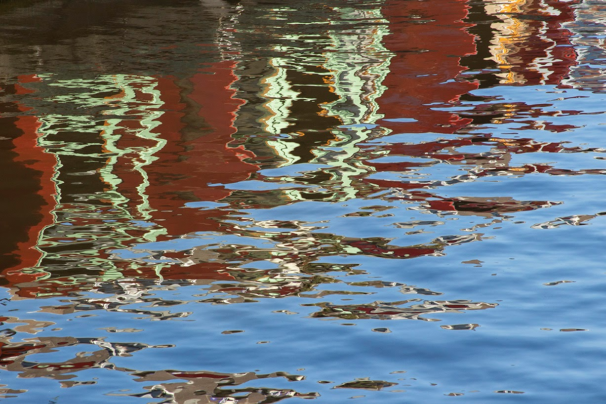 reflection of red canal boat