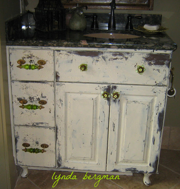 painting distressing a new bath cabinet to match an old bedroom