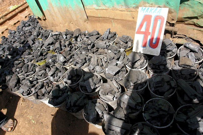 Buckets of polluting charcoal for sale in a slum area of Kenya's capital, Nairobi. (Credit: Thomas Stellmach via Flickr) Click to Enlarge.